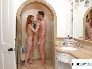 Redhead masseuse blows and takes clients cock